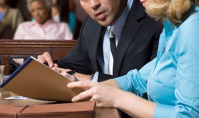 Lawyer defending client with jury in court